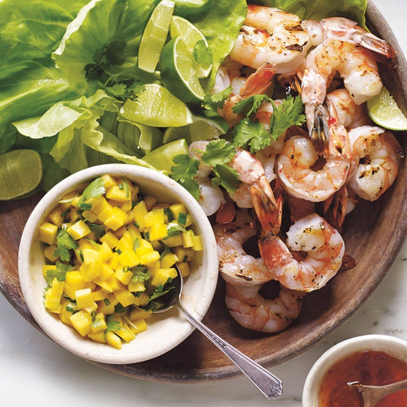 Photo of Grilled shrimp lettuce wraps with sweet chili sauce, mango, and toasted coconut by WW