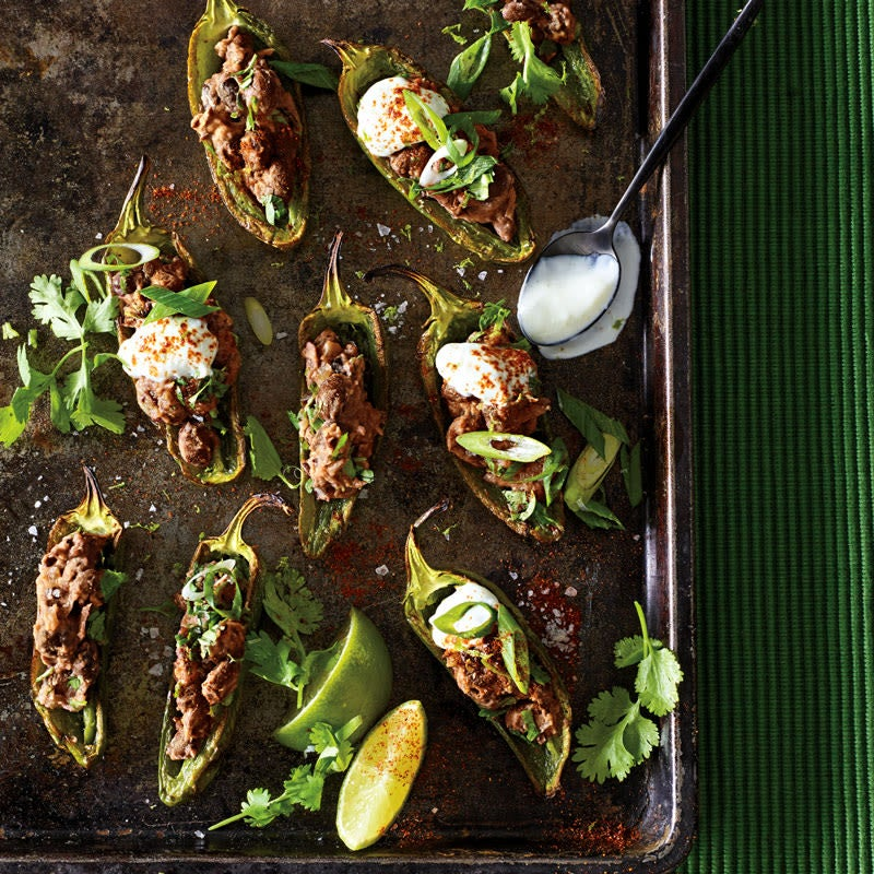 Photo of Broiled jalapeno poppers with black beans and lime cream by WW