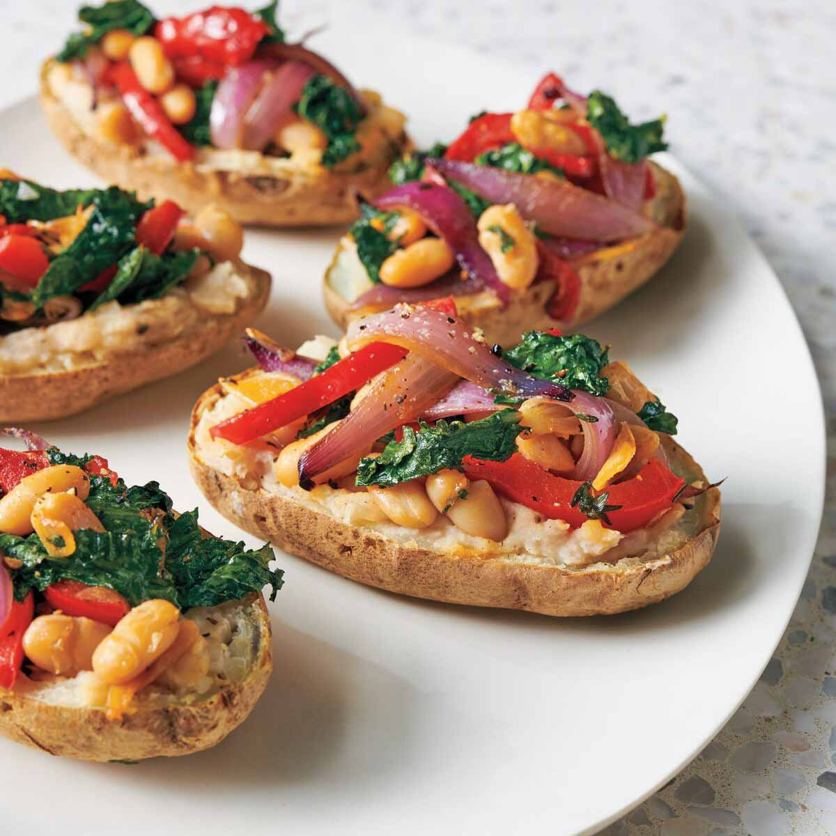 Photo of Garlicky kale and bean–stuffed potatoes by WW