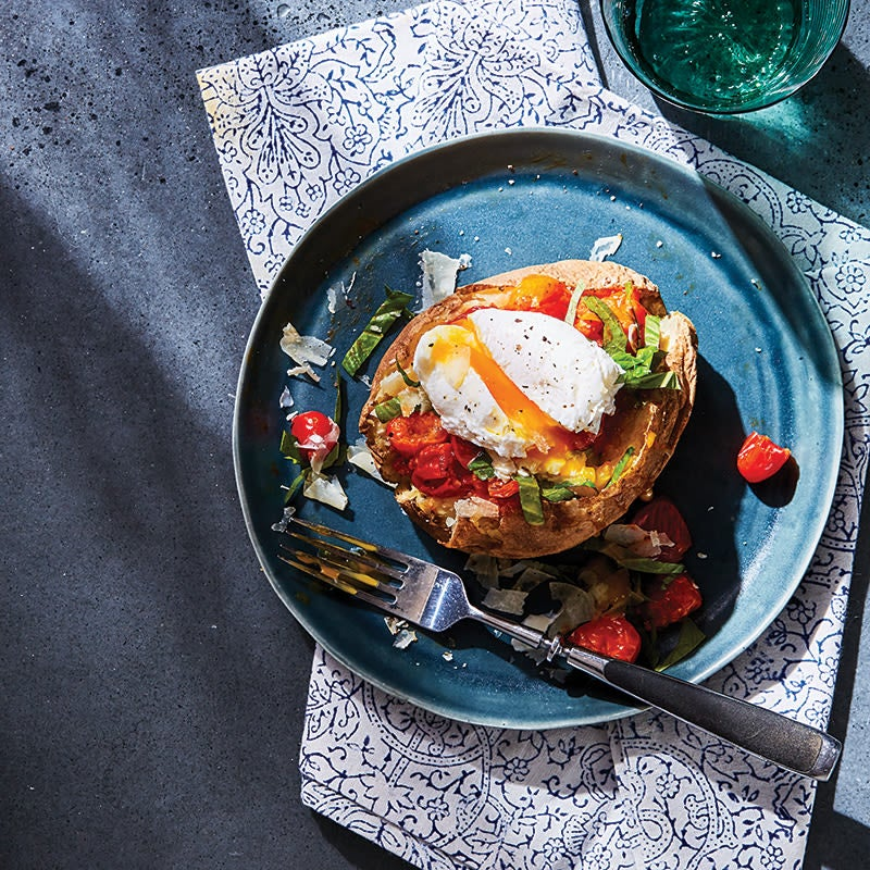 Photo of Baked potato with saucy tomatoes & a poached egg by WW