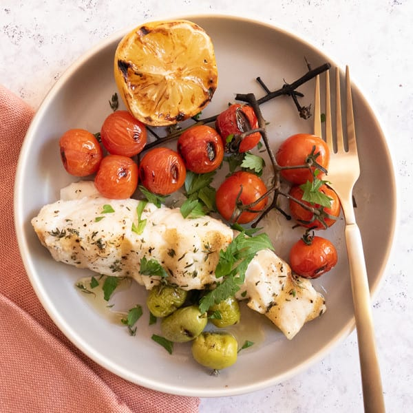 Photo of Grilled halibut with charred tomatoes, olives, and herbs by WW