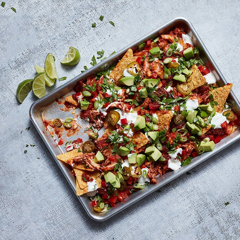 Photo of Chipotle-Pulled Chicken Nachos with Avocado and Lime Cream by WW