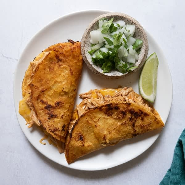 Photo of Cheesy chicken birria tacos by WW