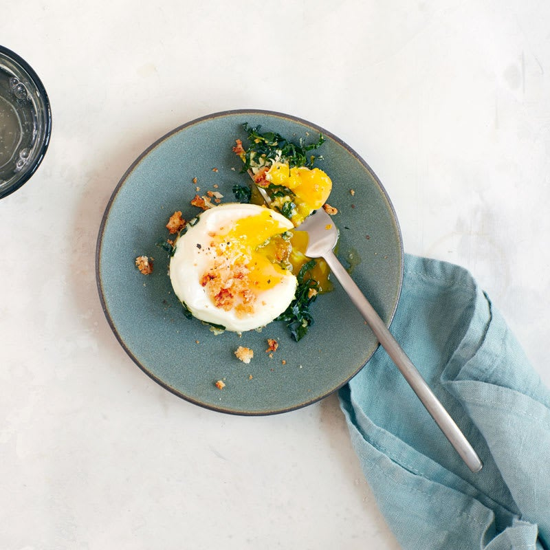 Photo of Baked eggs with kale Caesar salad by WW