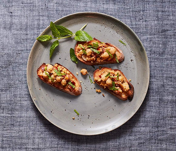 Photo of Crostini with Smashed Chickpeas, Sun-Dried Tomatoes and Mint by WW