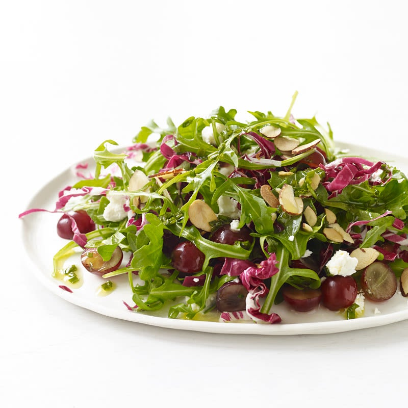 Photo of Arugula and radicchio with grapes, goat cheese and champagne vinaigrette by WW