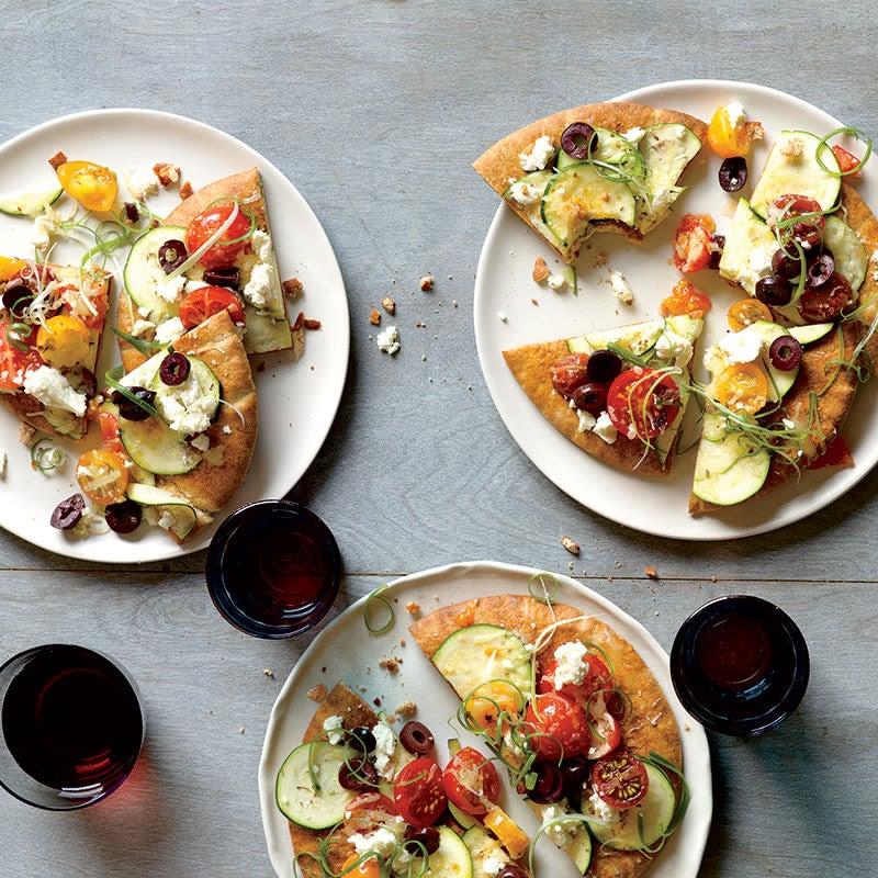 Photo of Zucchini and Tomato Pita Pizzas by WW