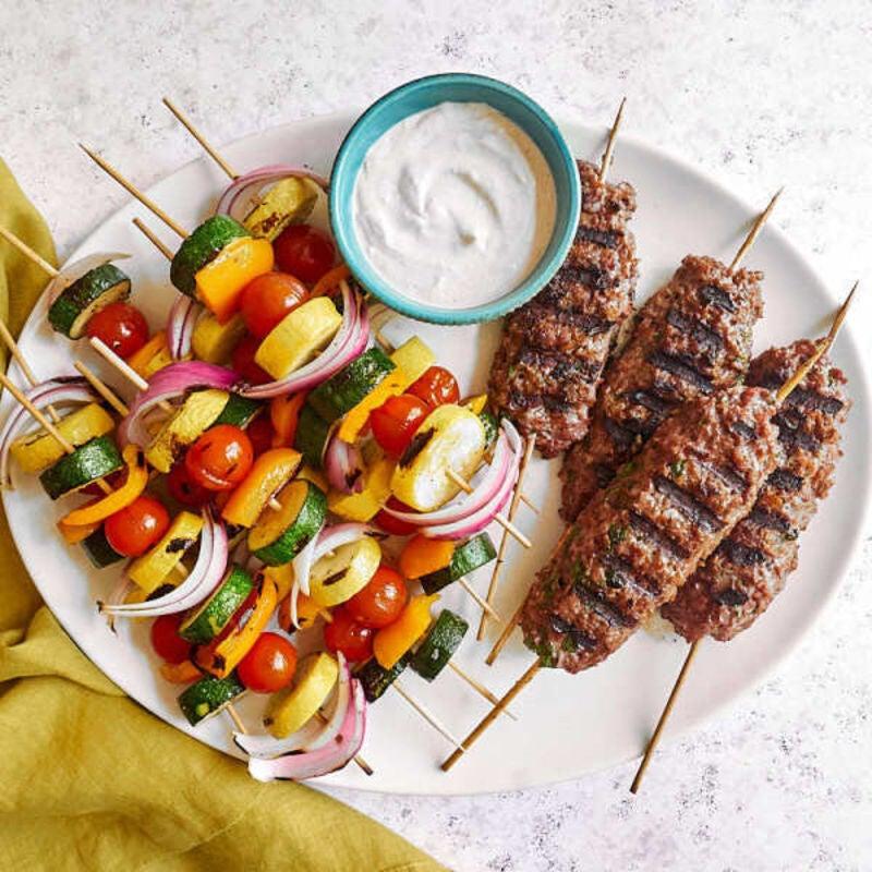 Photo of Beyond Meat kofta and vegetable kebabs with lemon-cumin yogurt sauce by WW