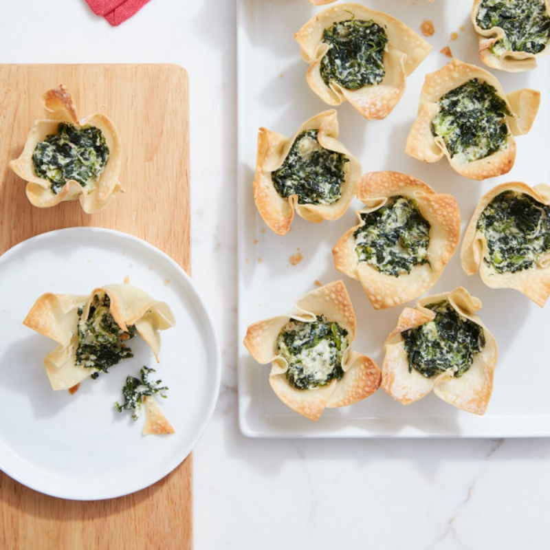 Photo of Cat Cora's mini spanakopita bites by WW