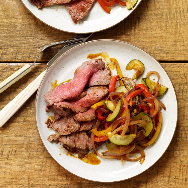 Photo of Spice-rubbed flank steak with fajita vegetables by WW