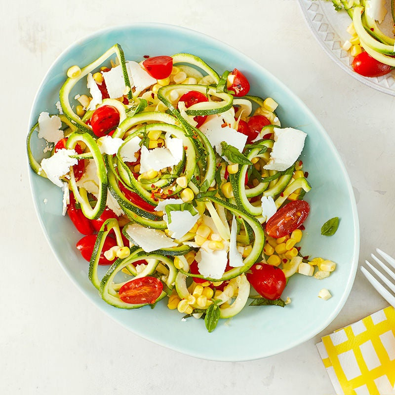 Photo of Zucchini noodle salad with tomatoes corn and basil by WW